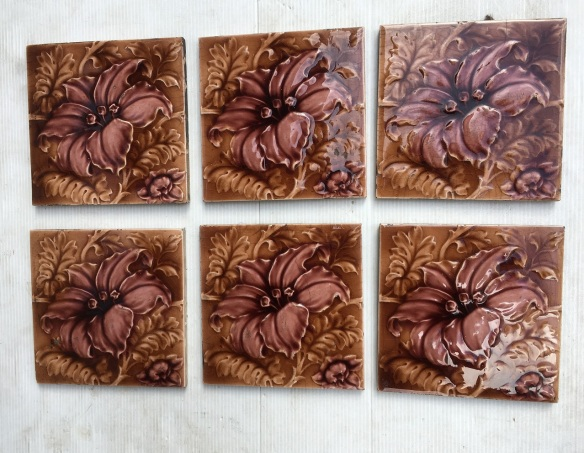 Sherwin and Cotton c1900, moulded floral design, in madder brown and dusky pink, 6 tiles available, $55 pair SET 233