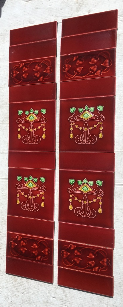 Circa 1899 Lea and Boulton Jewel tiles 6x6 inch with Sherwin moulded 3 x 6 tiles in rich burgundy wijth green and yellow, two panel fireplace set, $400 OTB 113 salvaged, vintage recycled, demolition, reproduction, restoration, home renovation secondhand, used , original, old, reclaimed, heritage, antique, victorian, art nouveau edwardian, georgian, art decoDetail of Deco style lettering to pub door