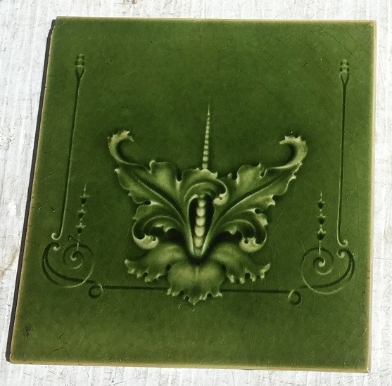 Detail of Original H Richards Tile Co, England c 1905, stylised flower / orchid? with fine scrolls, moulded tiles in monochrome olive green, 4 available, can sell as pairs. $84 per pair WS vintage salvaged 1800s 1900 1910 1920 1930 1940 1950 recycled demolition reproduction, restoration, renovation secondhand, used , original,old,reclaimed,heritage,antique, victorian,art nouveau edwardian, georgian,art deco