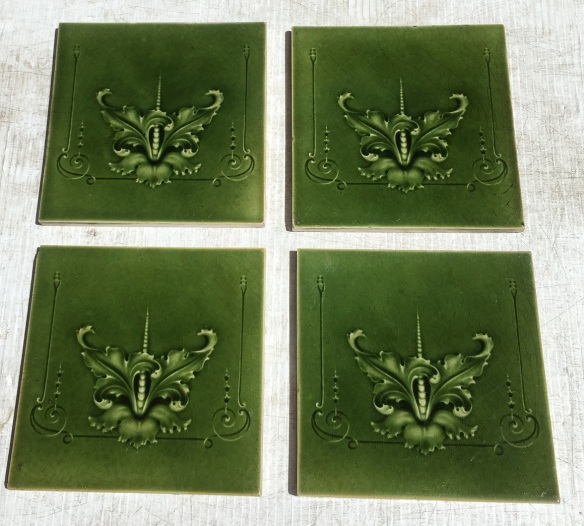 Original H Richards Tile Co, England c 1905, stylised flower / orchid? with fine scrolls, moulded tiles in monochrome olive green, 4 available, can sell as pairs. $84 per pair WS vintage salvaged mid century1800s 1900 1910 1920 1930 1940 1950 recycled demolition reproduction, restoration, renovation secondhand, used , original,old,reclaimed,heritage,antique, victorian,art nouveau edwardian, georgian,art deco