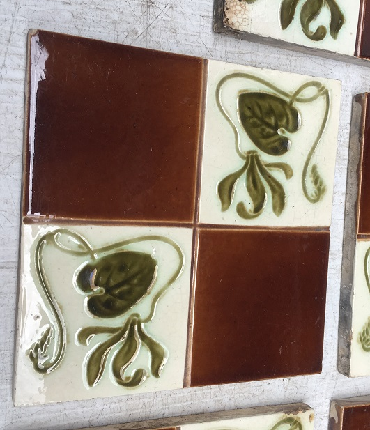 Detail of Original H Richards Tile Co, England c 1905, quartered design with stylised Art Nouveau flowers and foliage, glazed in teapot brown, olive green and cream, 155 x 155 x 12mm, 5 available, $18 each for the two with chips, $28 each for the three in good condition SET 242 Detail of Original H Richards Tile Co, England c 1905, quartered design with stylised Art Nouveau flowers and foliage, glazed in teapot brown, olive green and cream, 155 x 155 x 12mm, 5 available, $18 each for the two with chips, $28 each for the three in good condition vintage salvaged 1800s 1900 1910 1920 1930 1940 1950 recycled demolition reproduction, restoration, renovation secondhand, used , original,old,reclaimed,heritage,antique, victorian,art nouveau edwardian, georgian,art deco