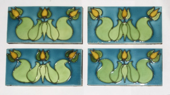 Rare H & R Johnson, England, c1915 Original hand tubelined collector tiles. Art Nouveau design trio of flowers in green and yellow on aqua glaze. 153 x 77 x 9mm, $85 for tile top left, $60 each for tiles with small chips. WS federation salvaged vintage recycled, demolition, reproduction, restoration, home renovation secondhand, used , original, old, reclaimed, heritage, antique, victorian, art nouveau edwardian, georgian, art deco