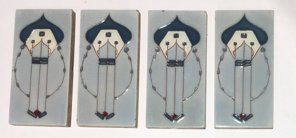 Very rare and unusual design 1930s, unknown maker, hand tubelined feature tiles with arabesque arch and geometric design elements. Powder blue background with steel blue and burgundy glaze. 4 available 153 x 76 x 11mm. $110 each WS Rare and unusual design 1930s, unknown maker, hand tubelined feature tiles with arabesque arch and geometric design elements. Powder blue background with steel blue and burgundy glaze. 4 available 153 x 76 x 11mm. $110 each SET 271 . 4 available $110 each SET 271federation salvaged vintage recycled, demolition, reproduction, restoration, home renovation secondhand, used , original, old, reclaimed, heritage, antique, victorian, art nouveau edwardian, georgian, art deco