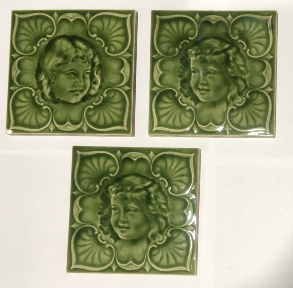 H Richards, England, c1905. Children moulded tiles, monochrome green, collectible, pair of faces $160; single child's face $75 WS, collectible, pair of faces $160; single child's face $75 WS federation salvaged vintage recycled, demolition, reproduction, restoration, home renovation secondhand, used , original, old, reclaimed, heritage, antique, victorian, art nouveau edwardian, georgian, art deco