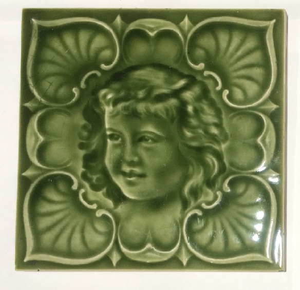 Detail of H Richards, England, c1905. Children moulded tiles, monochrome green, collectible, pair of faces $160; single child's face $75 WS federation salvaged vintage recycled, demolition, reproduction, restoration, home renovation secondhand, used , original, old, reclaimed, heritage, antique, victorian, art nouveau edwardian, georgian, art deco