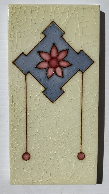 detail of rare hand tubelined tiles from the 1930s, likely maker is Malkin Tile Co, England. six petaled flower in pink, on lavender / blue geometric shape, pale yellow background. 7 available, collector tiles. $65 each SET 282 salvaged, recycled, demolition, reproduction, restoration, home renovation secondhand, used , original, old, reclaimed, heritage, antique, victorian, art nouveau edwardian, georgian, art deco