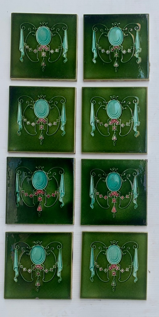 Circa 1895, T & R Boote, England. Art Nouveau majolica feature tiles, moulded jewel garland design, deep mint green and pink on mid green. Circa 1895, T & R Boote, Art Nouveau majolica feature tiles, moulded jewel garland design, deep mint green and pink on mid green. 8 tiles available, $84 per pair. SET 278 (another 4 tiles may be available in SET 271)salvaged, recycled, demolition, reproduction, restoration, home renovation secondhand, used , original, old, reclaimed, heritage, antique, victorian, art nouveau edwardian, georgian, art deco