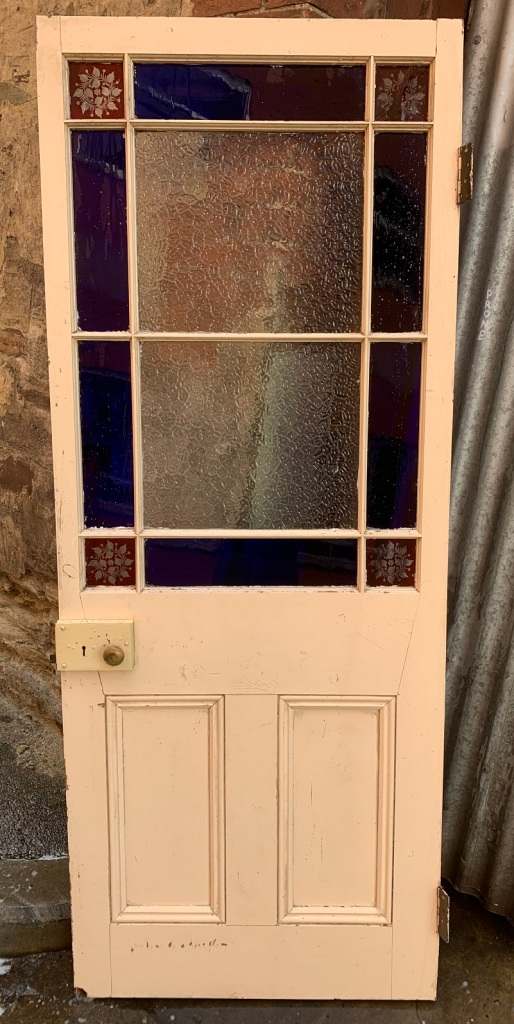 vintage salvaged 1800s 1900 1910 1920 1930 1940 1950 recycled demolition reproduction, restoration, renovation secondhand, used , original,old,reclaimed,heritage,antique, victorian,art nouveau edwardian, georgian,art decoEnd of passage door , with decorative corners ( one broken ) , crack to one blue glass piece , with rim lock , 1895 mm x 790 mm , $ 485