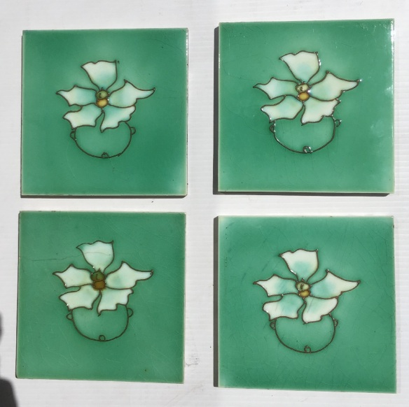 Hand tubelined design from Richards Tile Co. c 1920, white flower on soft green. 2 in better condition, $80 each, 1 with historic hairline crack & 1 with bleed in the craze lines, $60 each in SET 272salvaged, recycled, demolition, reproduction, restoration, home renovation secondhand, used , original, old, reclaimed, heritage, antique, victorian, art nouveau edwardian, georgian, art deco