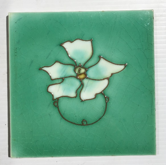 Detail of hand tubelined design from Richards Tile Co. c 1920, white flower on soft green. 2 in better condition, showing tile with some bleed in the craze lines, $60 in SET 272salvaged, recycled, demolition, reproduction, restoration, home renovation secondhand, used , original, old, reclaimed, heritage, antique, victorian, art nouveau edwardian, georgian, art deco