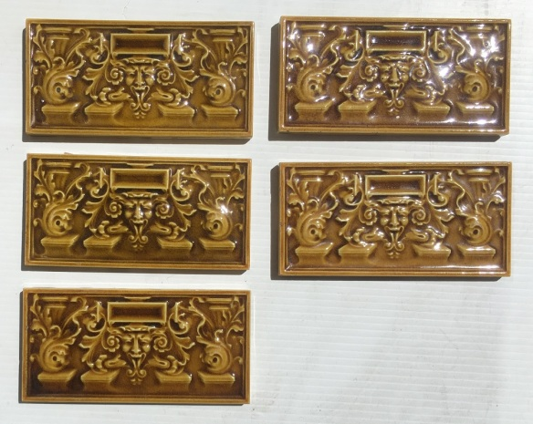 Circa 1900 original English 6 x 3 inch feature tiles, moulded, satyr face with Baroque scrolls, amber glaze, 5 available, $20 each WSsalvaged, recycled, demolition, reproduction, restoration, home renovation secondhand, used , original, old, reclaimed, heritage, antique, victorian, art nouveau edwardian, georgian, art deco