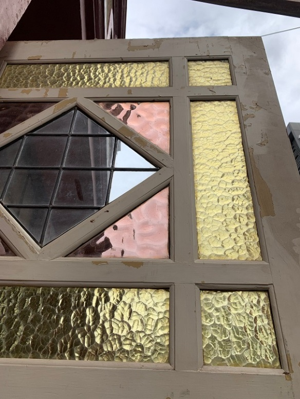 Detail of Unusual leadlight end of passage door, dusky pink, yellow and clear glass. width 1002 x height 2152mm, $300