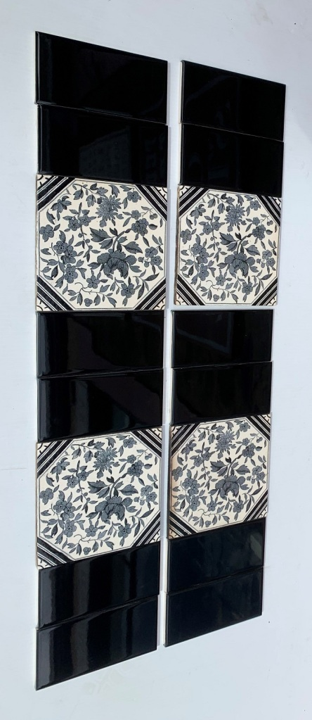 Black and white floral feature tiles, 1890-1900, Aesthetic style, two panel fireplace set with gloss black half tiles. $230 OTB 135 (additional 4 feature tiles may still be available in SET 135) salvaged, recycled, demolition, reproduction, restoration, home renovation secondhand, used , original, old, reclaimed, heritage, antique, victorian, art nouveau edwardian, georgian, art deco