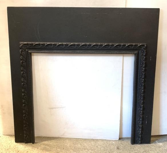 Heavy cast iron fireplace fascia with decorative border