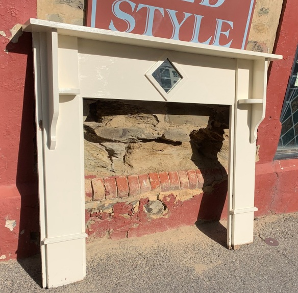 White painted timber fireplace surround, diamond shaped mirror in breastplate, top shelf width 1418mm x height 1215mm, $220salvaged, recycled, demolition, reproduction, restoration, home renovation secondhand, used , original, old, reclaimed, heritage, antique, victorian, art nouveau edwardian, georgian, art deco