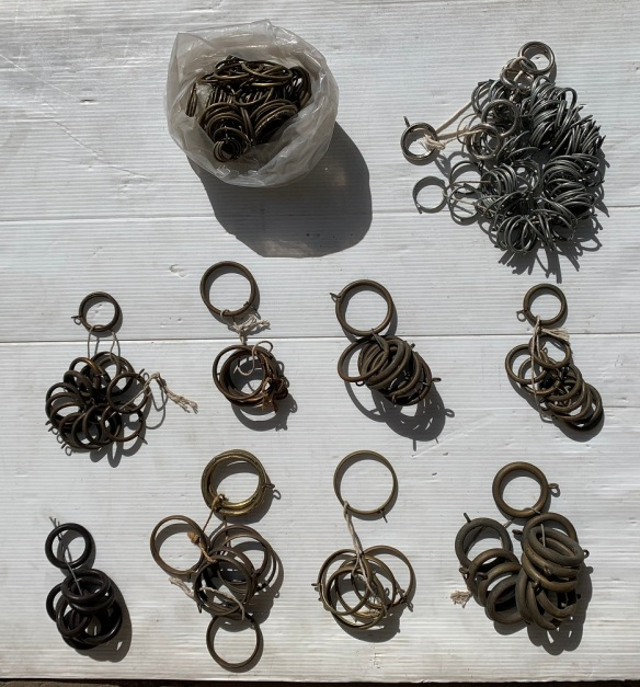 Assorted brass curtain rings, many vintage, most grouped, some loose salvaged, recycled, demolition, reproduction, restoration, home renovation secondhand, used , original, old, reclaimed, heritage, antique, victorian, art nouveau edwardian, georgian, art deco