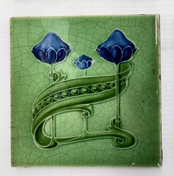 Detail of original T & R Boote, England fireplace feature tiles, Art Nouveau, c1905, royal blue flowers on mid green, $85 for the pair SET 274 salvaged vintage recycled, demolition, reproduction, restoration, home renovation secondhand, used , original, old, reclaimed, heritage, antique, victorian, art nouveau edwardian georgian art deco