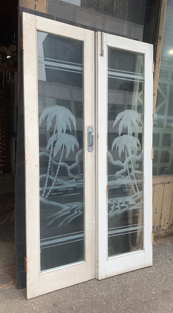 Etched glass French door pair with well detailed island scene, palm trees, sea and boat.